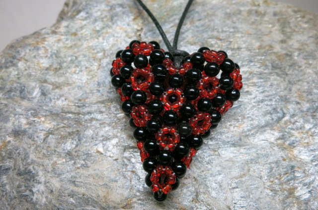 pendant heart black red colors threaded with leather tape front view