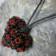 pendant heart black red colors threaded with leather tape knotted