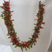 necklace collier colorful abundant fall autumn colors on white bust