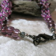 necklace collier abundant purple black colors closure in detail