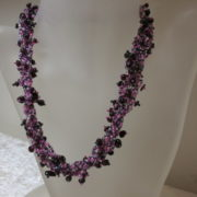 necklace collier abundant purple black colors on white bust