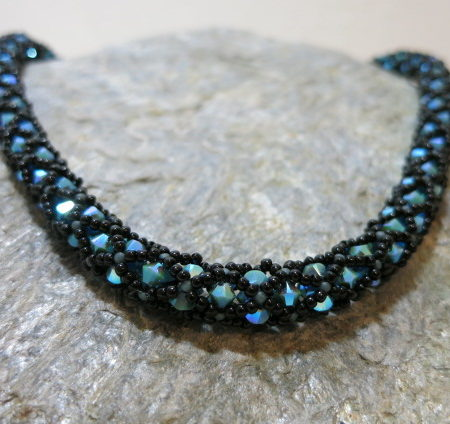 Swarowski necklace in Capri Blue with black near view on silvery stone