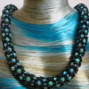 Swarowski necklace in Capri Blue with black on blue bust